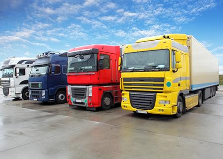Four Semi Trucks Parked in Lot