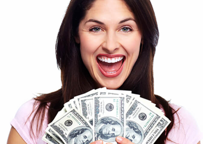 Woman holding one hundred dollar bills and smiling